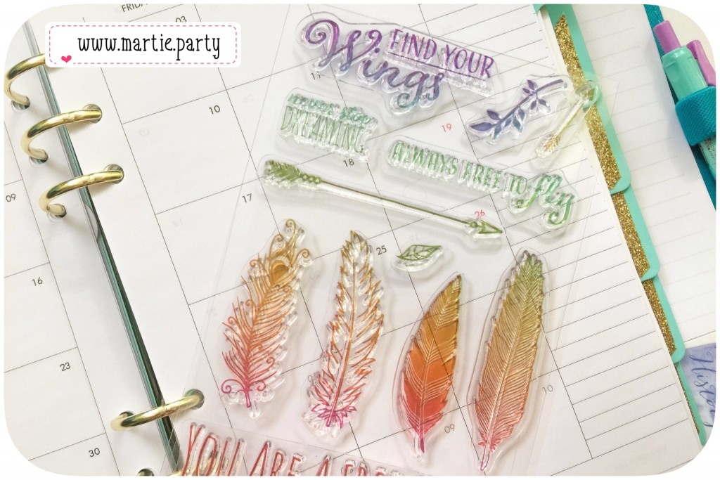 A sheet of clear stamps on a monthly planner page.