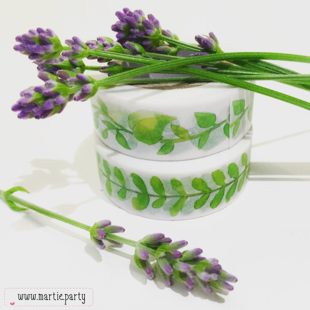 White washi with green leaves surrounded by fresh lavender.