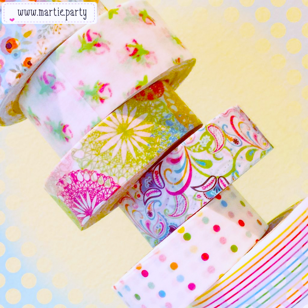 An irregular stack of colourful washi.