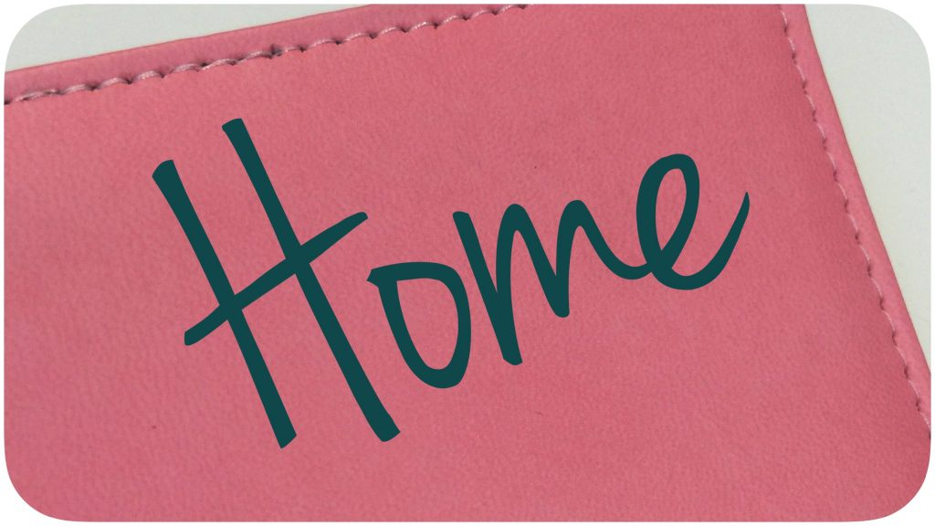 """Home"" written atop a planner."