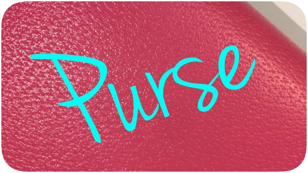 """Purse"" written atop a planner."