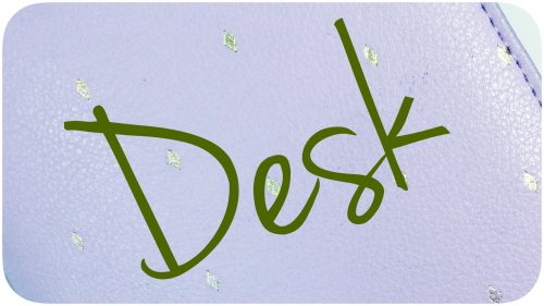 """Desk"" written atop a planner."